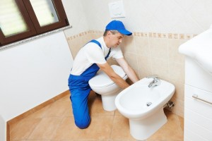 Chicago Area Plumber Installing A Toilet Base