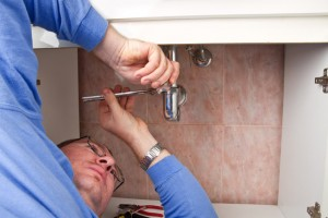 Chicago Plumber Unclogging Bathroom Sink