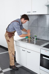 Clear a clogged kitchen sink pipe drain